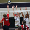 Carleen Ellerbruch of Lutheran West is able to tip the ball over the net for a point against Maddie Colahan and Taylor Hollis of Vermilion. Randy Meyers -- The Morning Journal