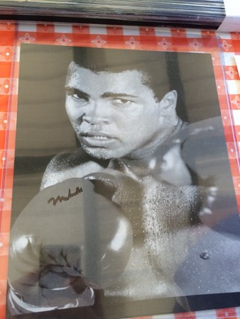 Mark Podolski - The News-Herald<br /> An autographed Muhammad Ali photo at the Bret Poklar Benefit Sept. 24 at Lost Nation Golf Course.