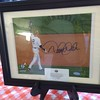 Mark Podolski - The News-Herald<br /> An autographed Derek Jeter photo up for auction at the Bret Poklar Benefit Sept. 24 at Lost Nation Golf Course.