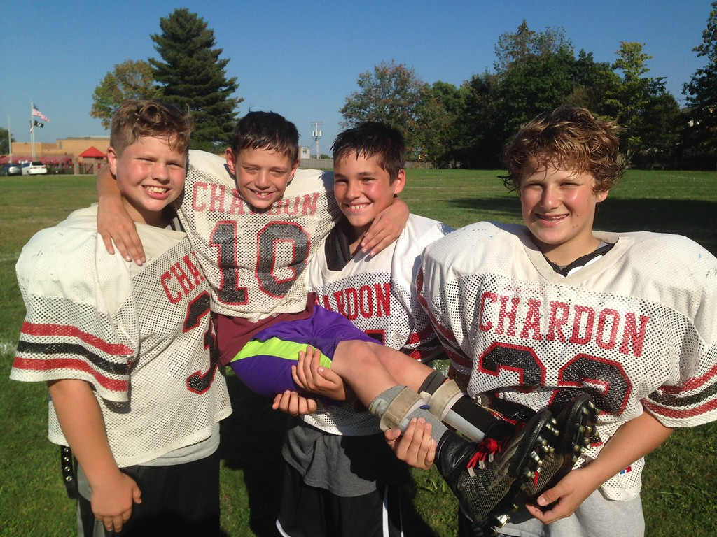 . John Kampf - The News-Herald Chardon seventh-grader Phillip Colucci, who suffers from cerebral palsy, scored a touchdown in his team\'s game against Willowick Middle School on Sept. 27 in Eastlake.