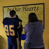 Tim Phillis - The News-Herald<br /> A Euclid player and fans admire a sign honoring Andre Jackson.