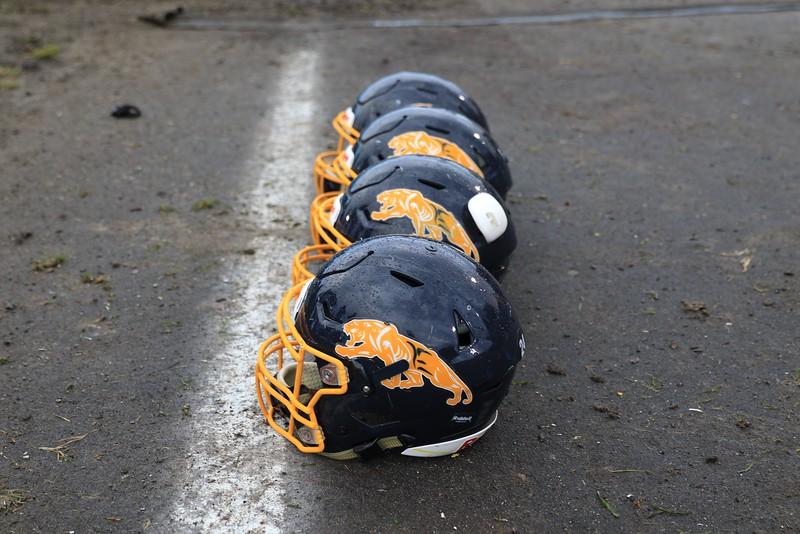 Tim Phillis - The News-Herald<br /> Euclid helmets line the field.