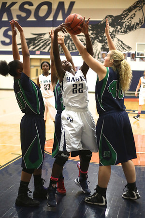 Hendrickson's Kaila Anthony fights for a rebound with three McNeil defenders on Tuesday at Hendrickson High School.