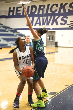 Hendrickson's Elizabeth Cooper works to get off a shot against McNeil on Tuesday.