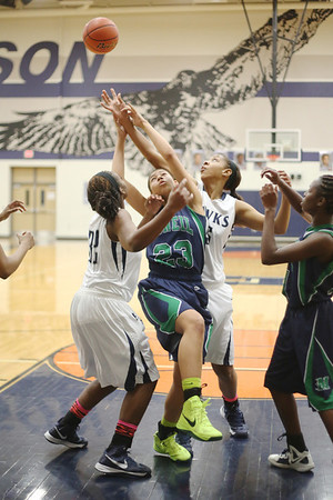 McNeil's Karissa Black battles for a rebound against a pair of Hendrickson defenders on Tuesday.