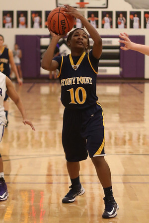 Stony Point's Oriannow Shillow attempts a shot against Cedar Ridge on Jan. 29
