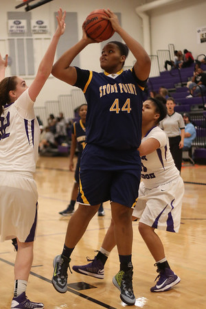 Stony Point's Jaiton Walls shoots between a a pair of Cedar Ridge defenders on Jan. 29