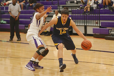 Stony Point's Miranda Simpson dribbles past a Cedar Ridge defender on Jan. 29