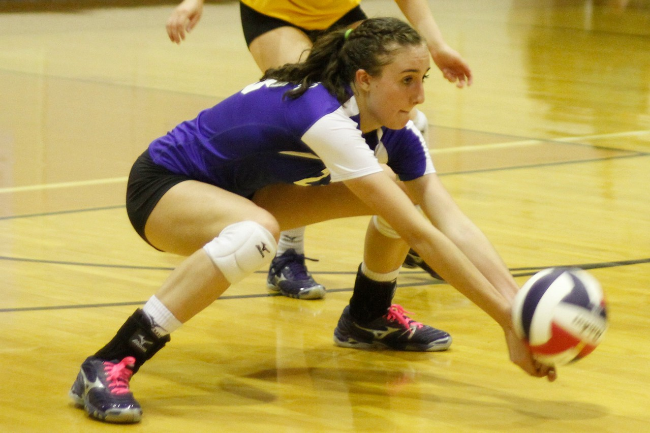Pflugerville's Madison Rigdon digs the ball against Westwood on Tuesday at Westwood High School.