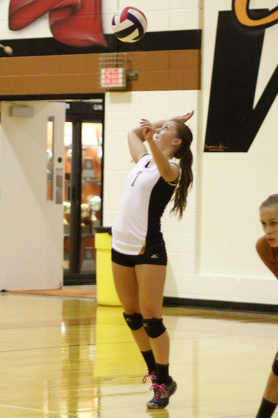 Westwood's Grace Yang serves against Pflugeville on Tuesday at Westwood High School.