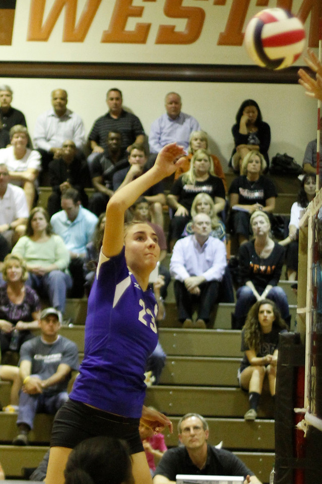 Pflugerville's Madison Rigdon goes for a kill against Westwood on Tuesday at Westwood High School.