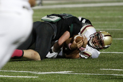 Rouse's Justin Pelt after a sack by Cedar Park Friday at Gupton Stadium.