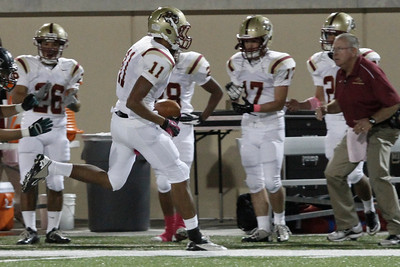 Rouse's Wesley Lewis makes a run with the ball against Cedar Park Friday at Gupton stadium.