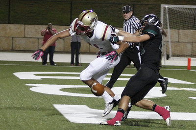Rouse's Lane Waller misses a catch against Cedar Park Friday at Gupton Stadium.
