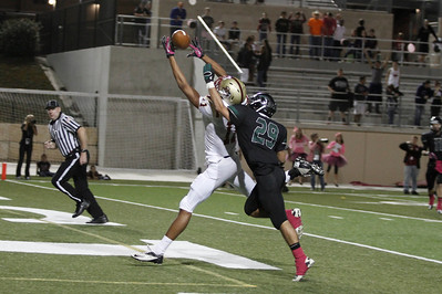 Rouse's Lane Waller attempts a catch against Cedar Park Friday at Gupton Stadium.