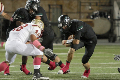 Cedar Parks Nate Grimm makes a run against Rouse Friday at Gupton stadium.