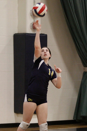 Stony Point's Lauren Tippett serves against McNeil on Tuesday at McNeil High School.