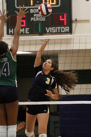 Stony Point's Sofia Gruden goes for a kill over to net against McNeil on Tuesday at McNeil High School.