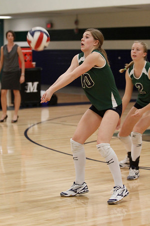 McNeil's Hannah Weaver digs the ball against Stony Point on Tuesday at McNeil High School.