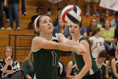McNeil's Sami Fraizer digs the ball against Stony Point on Tuesday at McNeil High School.