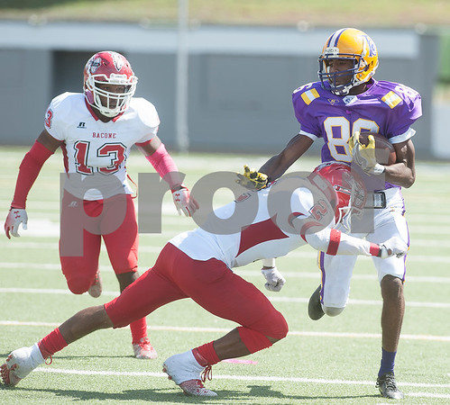 Texas College's (86) Michael Williams is tackled by Bacone College's (2) Erik King during their game Saturday afternoon at Christus Trinity Mother Frances Rose Stadium in Tyler.   (Sarah A. Miller/Tyler Morning Telegraph)