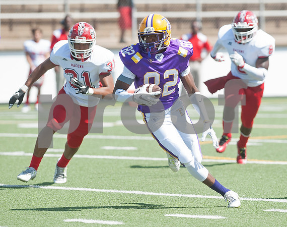 Texas College's (82) Christopher Henry carries the ball as the Steers play Bacone College Saturday afternoon at Christus Trinity Mother Frances Rose Stadium in Tyler.   (Sarah A. Miller/Tyler Morning Telegraph)