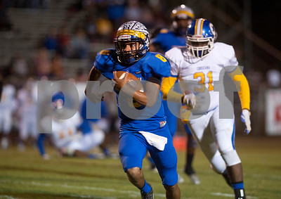 Jacksonville's Cameron High carries the ball with Corsicana's Davareon Martin trailing behind Friday night at the Tomato Bowl.  (Sarah A. Miller/Tyler Morning Telegraph)
