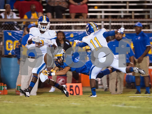 The ball slips away from Jacksonville's Christian Edwards as he attempts to intercept the ball from Corsicana's Donte Polk Friday night at the Tomato Bowl.  (Sarah A. Miller/Tyler Morning Telegraph)