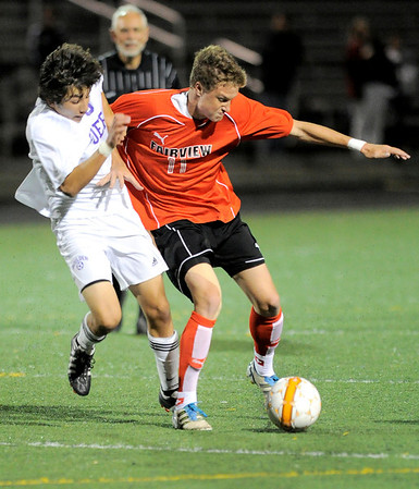 Boulder's Jake Smits (left) and Fairview's Eric Kronenberg (right) fight for the ball during their soccer game at Recht Field in Boulder, Colorado October 4, 2011.  CAMERA/Mark Leffingwell