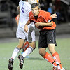 Fairview's Amos Nash (right) heads the ball away from Boulder's Jake Smits (left) during their soccer game at Recht Field in Boulder, Colorado October 4, 2011.  CAMERA/Mark Leffingwell