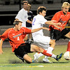 Fairview's Ollie Gerland (left) and Derek Mahalek (right) cut off Boulder's Kyle Hawkings (middle) during their soccer game at Recht Field in Boulder, Colorado October 4, 2011.  CAMERA/Mark Leffingwell