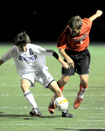 Boulder's Jake Smits (left) steals the ball from Amos Nash (right) Fairview's  during their soccer game at Recht Field in Boulder, Colorado October 4, 2011.  CAMERA/Mark Leffingwell