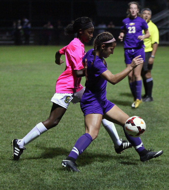 . Avon\'s Abby Delprincipe bodies McKenzie Wright of Amherst away from the ball during the first half. Randy Meyers -- The Morning Journal
