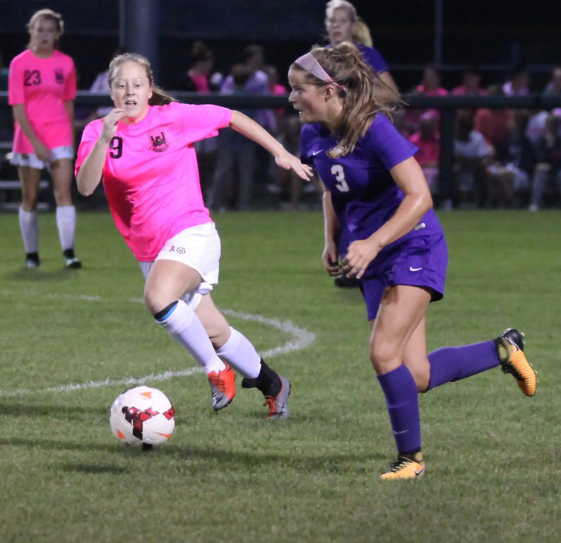 . Avon\'s Emily Dahl moves the ball past Emily Gray of Amherst near midfield during the first half. Randy Meyers -- the Morning Journal