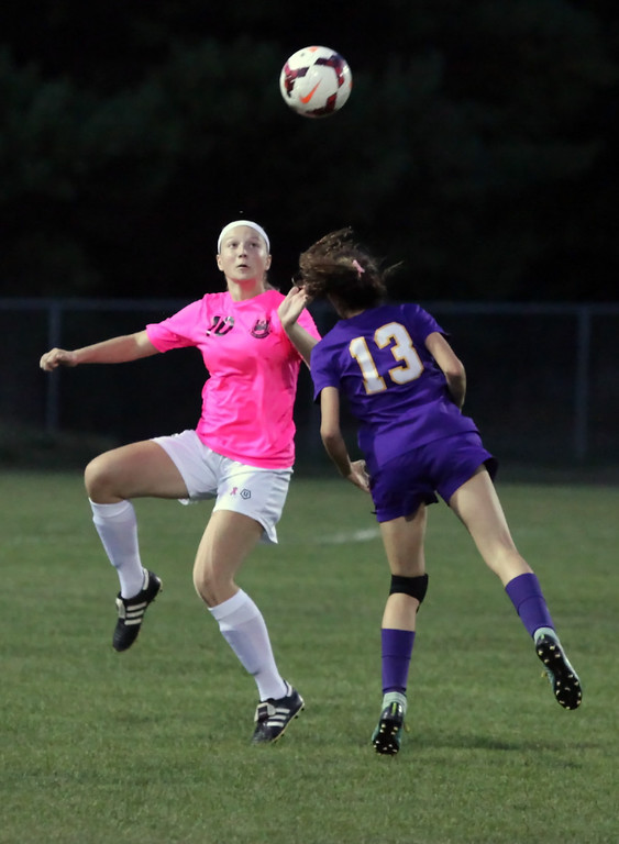 . Avon\'s Karissa Kraszewski haeds the ball in front of Kamryn Dziak of Amherst during the first half. Randy Meyers -- The Morning Journal