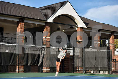 Robert E. Lee's Claire Fisher serves the ball during a high school district tennis match at Tyler Junior College in Tyler, Texas, on Wednesday, Oct. 4, 2017. (Chelsea Purgahn/Tyler Morning Telegraph)
