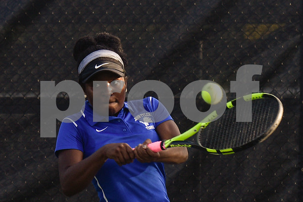 John Tyler's Mackenzie Wade hits the ball during a high school district tennis match at Tyler Junior College in Tyler, Texas, on Wednesday, Oct. 4, 2017. (Chelsea Purgahn/Tyler Morning Telegraph)