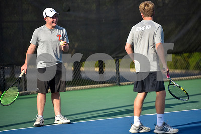 Robert E. Lee's Nathan Drain chats with doubles partner Evan Von Eschenbauch before he serves during a high school district tennis match at Tyler Junior College in Tyler, Texas, on Wednesday, Oct. 4, 2017. (Chelsea Purgahn/Tyler Morning Telegraph)