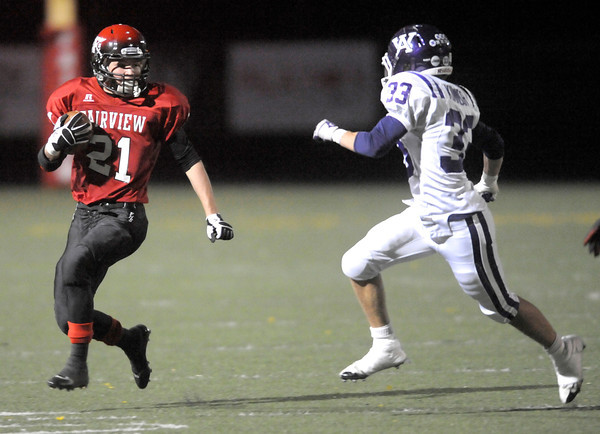 Fairview's Cameron Frazier (left) makes a 21-yard punt return before being tackled by Arvada West's Ian Kinnear (right) during their football game at Recht Field in Boulder, Colorado October 6, 2011.  CAMERA/Mark Leffingwell