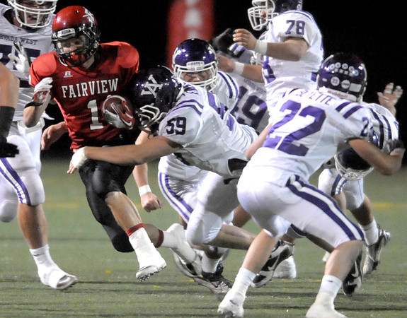 Fairview's Cole Scheifele (left) is tackled by Arvada West's Matt Evans (left) after a gain during their football game at Recht Field in Boulder, Colorado October 6, 2011.  CAMERA/Mark Leffingwell