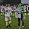 Andrew Ferguson (20) stops to touch the jersey for Jakob Hwang before the game. Amanda K. Rundle -- The Morning Journal