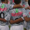 "The Elyria Catholic boys soccer team wears green ribbons that have ""J. Hwang"" written on them on their jerseys. Goalkeeper Jakob Hwang is battling cancer. Amanda K. Rundle -- The Morning Journal"