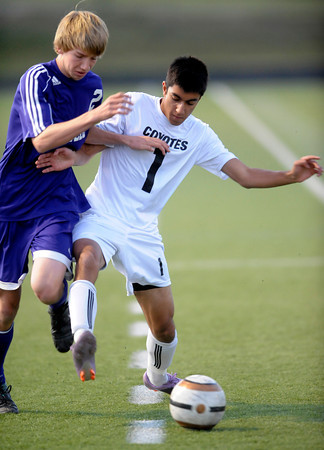Monarch's Jan Amr (right) fights Boulder's Kevin Lieshout (left) for the ball during their soccer game at Monarch High School in Louisville, Colorado October 11, 2011.  CAMERA/Mark Leffingwell