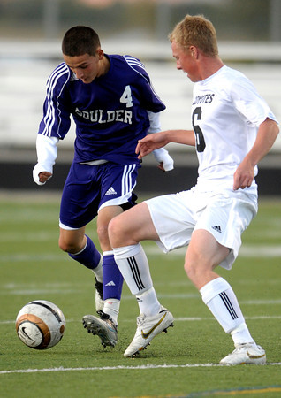 Boulder's Ivan Ramirez (left) and Jamie Falloon (right) go for the ball Monarch's during their soccer game at Monarch High School in Louisville, Colorado October 11, 2011.  CAMERA/Mark Leffingwell