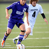 Boulder's Miles Chow (left) takes the ball toward the goal while being chased by Monarch's Sam Baur (right) during their soccer game at Monarch High School in Louisville, Colorado October 11, 2011.  CAMERA/Mark Leffingwell