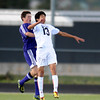 Monarch's Clyde Glastetter (right) and Boulder's Jake Lowell (left) go for the ball during their soccer game at Monarch High School in Louisville, Colorado October 11, 2011.  CAMERA/Mark Leffingwell