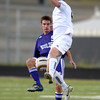 Boulder's Ben Kates (left) passes the ball past Monarch's Jamie Falloon (right) during their soccer game at Monarch High School in Louisville, Colorado October 11, 2011.  CAMERA/Mark Leffingwell