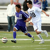 Monarch's Michael Maulsby (right) and Boulder's Rojesh Shrestha (left) race for the ball during their soccer game at Monarch High School in Louisville, Colorado October 11, 2011.  CAMERA/Mark Leffingwell