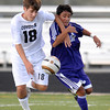 Monarch's Austin Passwaters (left) tries to block Boulder's Rojesh Shrestha (right) during their soccer game at Monarch High School in Louisville, Colorado October 11, 2011.  CAMERA/Mark Leffingwell