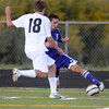 Boulder's Ben Kates (right) passes the ball off around Monarch's Austin Passwaters (left) during their soccer game at Monarch High School in Louisville, Colorado October 11, 2011.  CAMERA/Mark Leffingwell